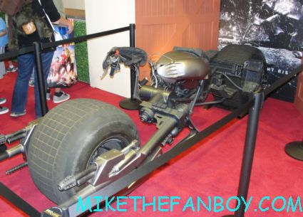 anne hathway's catwoman motorcycle from the dark knight rises on display at the Warner Bros booth at san diego comic con 2012 rare promo costume display