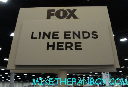 mike the fanboy holding the end of the line sign at san diego comic con sdcc 2012 for the fox booth wilfred autograph signing