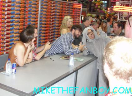 the cast of wilfred signing autographs for fans at the san diego comic con sdcc 2012 elijah wood rare signature fox booth