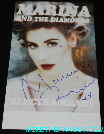 marina and the diamonds signed autograph rare promo poster signature marina and the diamonds signing autographs for fans Marina Lambrini Diamandis welsh singer songwriter signing a rare promo poster autograph