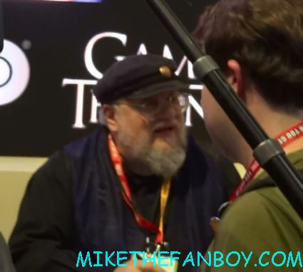george rr martin game of thrones cast autograph signing at the warner bros booth Emilia Clarke and alfie signing autographs at the warner bros booth at comic con 2012 sdcc 2012 game of thrones cast signing