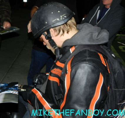 sons of anarchy star charlie hunnam signing autographs for fans outside the set of sons of anarchy on the set of sons of anarchy waiting for Charlie hunnam to finish and sign autographs for fans