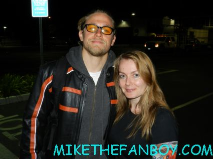 annette and charlie hunnam from sons of anarchy posing for a fan photo sons of anarchy star charlie hunnam signing autographs for fans outside the set of sons of anarchy on the set of sons of anarchy waiting for Charlie hunnam to finish and sign autographs for fans