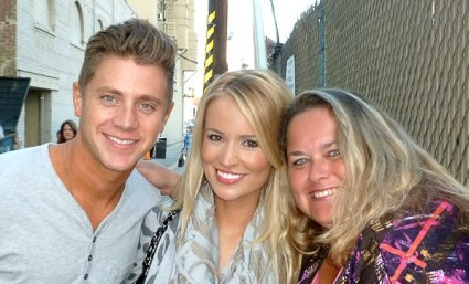 pinky from mike the fanboy with emily maynard and jef holm from the bachelorette posing for a fan photo with lindsay