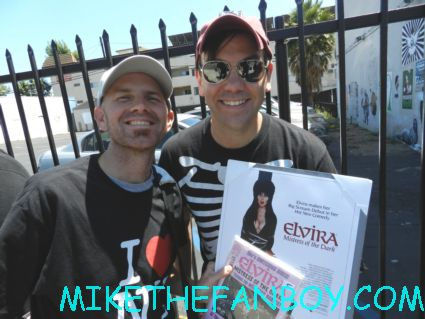 scotty and scott posing in front of the elvira banner scott douglas moore waiting for elvira to sign his dvd at the golden apple comics in los angeles