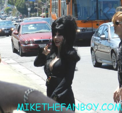 elvira arriving in front of golden apple comics to sign autographs for fans looking hot and sexy elvira mistress of the dark