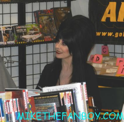 elvira mistress of the dark signing autographs for fans at golden apple comics in los angeles looking hot and sexy elvira arriving in front of golden apple comics to sign autographs for fans looking hot and sexy elvira mistress of the dark