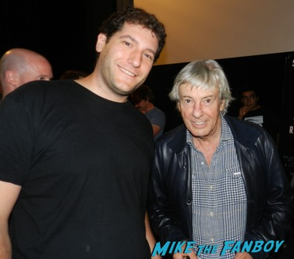 Paul Verhoeven posing for a fan photo with mike the fanboy at a q and a for total recall at the egyptian theater paul verhoven signing autographs for fans 006
