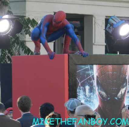 a man dressed up like spider man on the red carpet The amazing spider man world movie premiere with andrew garfield emma stone rhys ifans rare signing autographs for fans