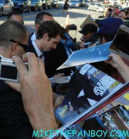 andrew garfield signing autographs for fans at the a man dressed up like spider man on the red carpet The amazing spider man world movie premiere with andrew garfield emma stone rhys ifans rare signing autographs for fans