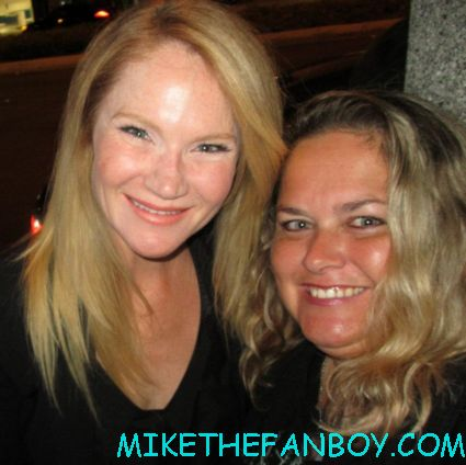 tara buck  posing for a fan photo at the true blood season 5 wrap party hot sexy cougar town star