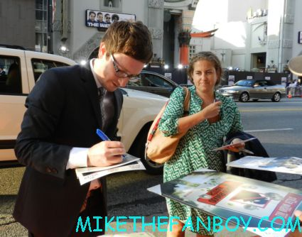 Akiva Schaffer signing autographs at the world premiere of the watch at the chinese theatre in hollywood