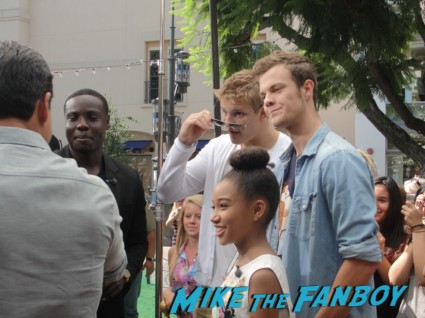 Amandla Stenberg (Rue), Alexander Ludwig (Cato), Jack Quaid (Marvel), and Dayo Okeniyi (Thresh) at a promotional stop for the hunger games dvd on extra at the grove rare promo hot sexy