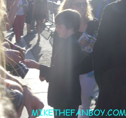 CJ adams signing autographs at bella thorne arriving to the the odd life of timothy green world movie premiere red carpet with jennifer garner and joel edgerton