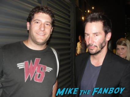 Mike the fanboy with Speed and bill and ted's excellent adventure star keanu reeves posing for a fan photo