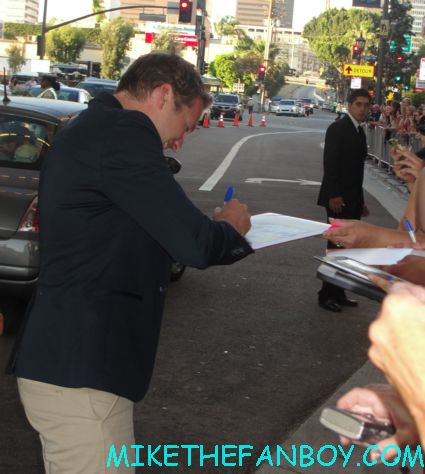 veronica mars star ryan hansen signing autographs for fans at the hit and run movie premiere