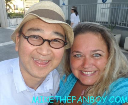 Gedde Watanabe AKA long duk dong from 16 candles sixteen candles taking a fan photo with pinky from mike the fanboy
