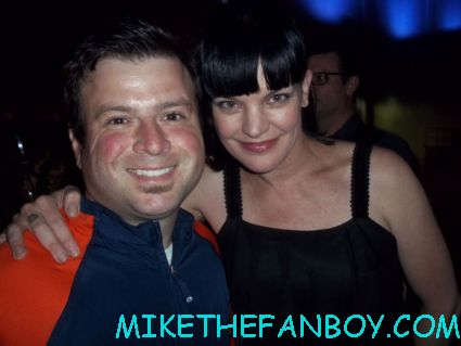 billy beer posing for a fan photo with pauley perrette at the hit and run movie premiere