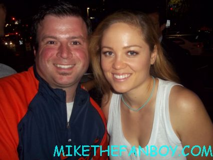 billy beer posing for a fan photo with erika christianson from parenthood at the hit and run movie premiere