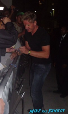 Gordon Ramsay  signing autographs for fans after doing a promotional appearance for hell's kitchen