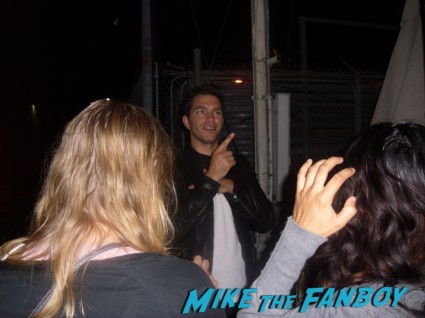 hot sexy andy grammer  signing autographs for fans after doing a promotional appearance for his new cd