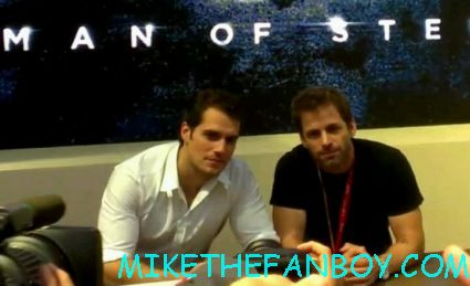 Henry Cavill hot and sexy with zach snyder  at the man of steel autograph signing at the WB booth for man of steel rare promo