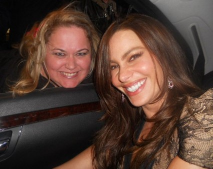 sofia vergara from modern family posing for a fan photo with pinky from mike the fanboy signed autograph
