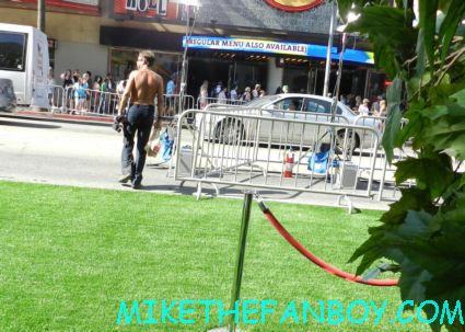 odd shirtless man wandering around hollywood blvd the odd life of timothy green world movie premiere in hollywood at the el capitan theatre rare promo jennifer garner joel edgerton