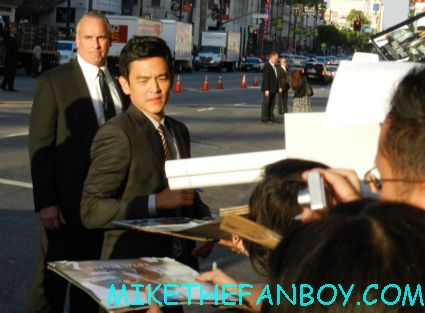 john cho signing autographs for fans at the total recall world movie premiere in hollywood