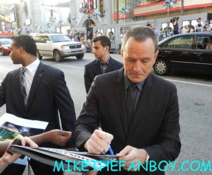 bryan cranston signing autographs for fans at the total recall world movie premiere in hollywood