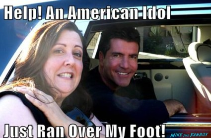 Suddenly susan posing with American Idol star Simon Cowell at a talk show taping and getting a major photo flop!  Signed autograph rare