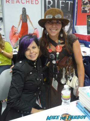 Heather Brewer posing with mike the fanboy's the novel strumpet at san diego comic con 2012