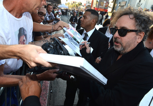 Tim Burton signing autographs for fans at the Frankenweenie hollywood movie premiere el capitan theater tim burton catherine O'Hara winona ryder rare signing autographs