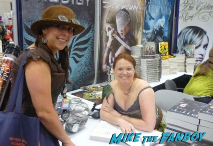Andrea Cremer posing with mike the fanboy's the novel strumpet at san diego comic con 2012