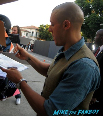 Theo Rossi signs autographs for fans at the sons of anarchy world premiere in westwood rare promo