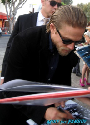 sexy charlie hunnam signs autographs for fans at the sons of anarchy world premiere in westwood rare promo