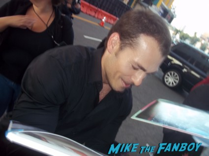 sexy Shawn Roberts signing autographs for fans at the Resident Evil: Retribution movie premiere red carpet with milla jovovich Boris Kodjoe, Shawn Roberts, Oded Fehr and Kevin Duran