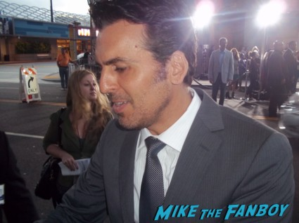sexy Oded Fehr signing autographs for fans at the Resident Evil: Retribution movie premiere red carpet with milla jovovich Boris Kodjoe, Shawn Roberts, Oded Fehr and Kevin Duran