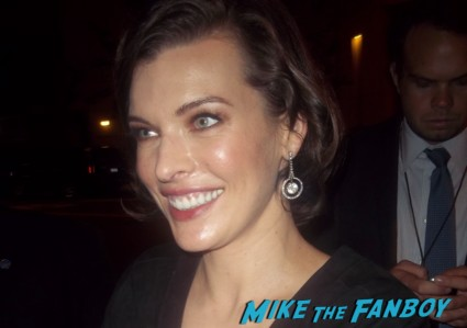 sexy milla jovovich signing autographs for fans at the Resident Evil: Retribution movie premiere red carpet with milla jovovich Boris Kodjoe, Shawn Roberts, Oded Fehr and Kevin Duran