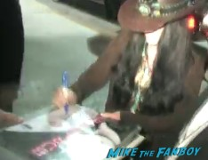 cher signing autographs for fans at the zookeeper world movie premiere in westwood villiage