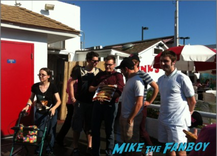 The cast of the uk hit film the inbetweeners at pink's hot dogs in los angeles Simon Bird, James Buckley, Blake Harrison and Joe Thomas