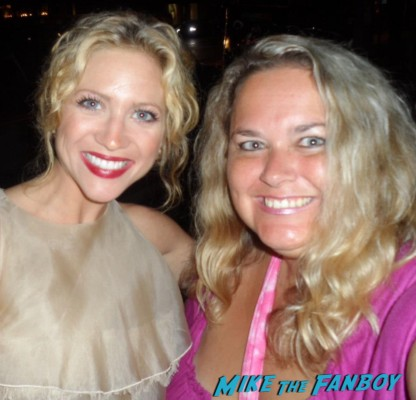 brittany snow   posing for a photo with pinky from mike the fanboy at an emmy party in beverly hills
