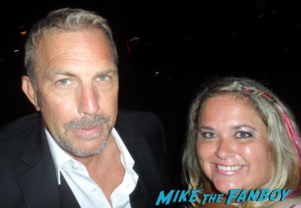 kevin costner posing for a fan photo with pinky from mike the fanboy at the emmy awards 2012 hot sexy mad men star