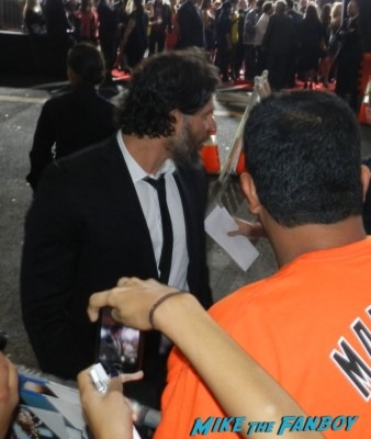 Joe Manganiello signing autographs for fans at the end of watch movie premiere jake gylenhall signing autographs 039