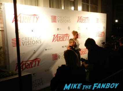 Maria Bello signing autographs for fans at an emmy week party prime suspect funky hat star