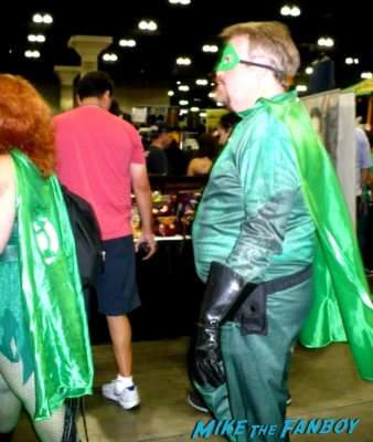 husky green hornet  cosplayer at stan lee's comikaze expo 2012 sweating in the heat of the day
