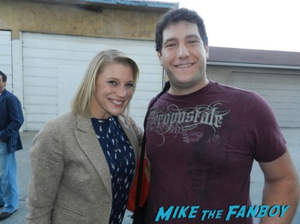 Katee Sackhoff posing with mike the fanboy for a fan photo hot katee sackhoff signing autographs for fans looking hot and sexy rare battlestar galactica starbuck photo shoot rare promo 24 longmire
