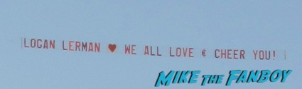 a sign being pulled by an airplane that says logan lerman we all love and cheer you The Perks Of Being A Wallflower Movie Premiere and emma watson dissing hundreds of fans rude nasty emma watson