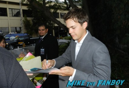 Johnny Simmons signs autographs for fans on the red carpet at the perks of a wallflower movie premiere rare promo signed