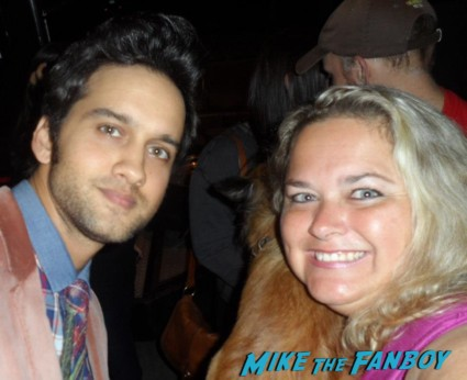 michael steger posing for a photo with pinky from mike the fanboy at an emmy party in beverly hills